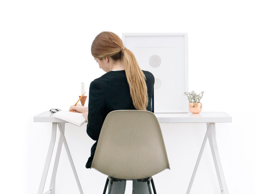 Girl working at white desk